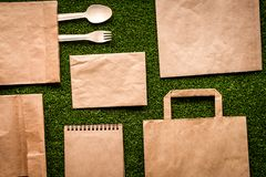 Take out in paper bag on green background top view stock image