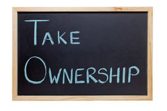 Take Ownership Blackboard. Blackboard with the words Take Ownership - ideal for presentations and training Royalty Free Stock Image