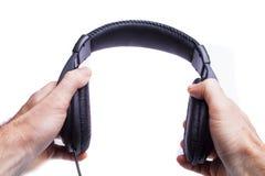 Take på hörlurar Arkivfoto
