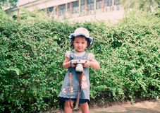 Take a photo. The baby girl child Take a photo with digital camera in the garden Stock Images