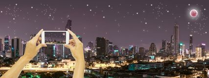 Take photo at Bangkok building at night time. With Super moon blue moon blood moon Royalty Free Stock Photography