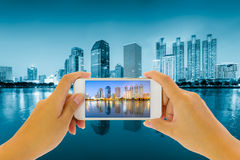 Take photo. Concept of smart phone take photo with scenery of bangkok at night Royalty Free Stock Photo