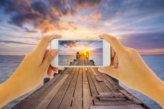 Take photo. Concept of smart phone take photo at seaside royalty free stock photography