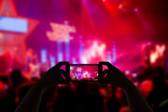 Take photo concert in front of stage Stock Photography