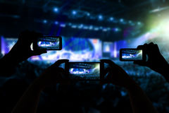 Take photo crowd in front of concert stage blurred Stock Photos