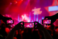 Take photo crowd in front of concert stage blurred Royalty Free Stock Image