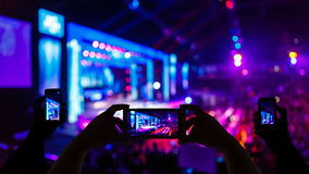 Take photo crowd in front of concert stage blurred Stock Photo