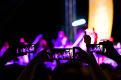 Take photo crowd in front of concert stage blurred Stock Image