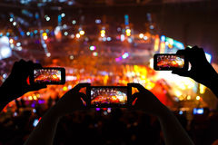 Take photo crowd in front of concert stage blurred Royalty Free Stock Photos