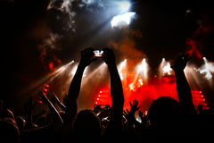 Take photo in front of concert stage Royalty Free Stock Image