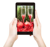 Take photo of red Xmas still life with tablet pc Royalty Free Stock Photography