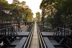 Take photo side railway of bridge over the river kwai ,historical steel bridge of World War II stock photography