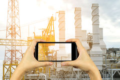 take photo with smartphone. Oil and gas platform in the gulf or Royalty Free Stock Image