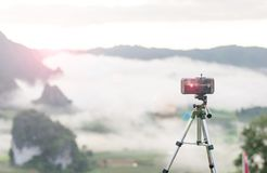 Take a photo sun rise by phone Stock Photography