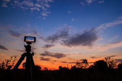 Take photo or timelapse by mobile. In evening with tripod Stock Photography