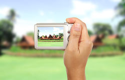 Take a photography. Hand and camera take Thai house photography outdoor Stock Images