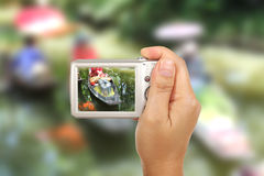 Take a photography. Hand and camera take Thai floating market photography outdoor stock photography