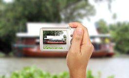 Take a photography. Hand and camera take boat restaurant photography outdoor Royalty Free Stock Images