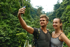 Take Photos. Couple Of Tourist Making Selfie On Vacation. Travel royalty free stock photography