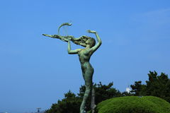 Take piano woman. The landmark sculpture in the  park of small Qingdao Stock Photo