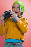 Take a picture!. Excited girl holding an old analog camera Royalty Free Stock Photos