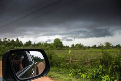 Take a picture of a storm in the car stock photos