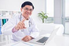 Take these pills! Stock Photos