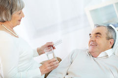 Take pills Stock Image