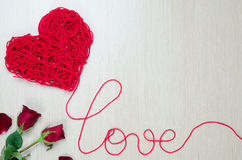 Take a red yarn into heart shape Royalty Free Stock Photography