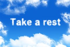 Take a rest - cloud word. On blue sky background Stock Images