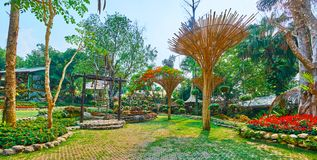 Take a rest in Mae Fah Luang garden, Doi Tung, Thailand. Take a rest in ornamental Mae Fah Luang garden, decorated with interesting bamboo sunshades, Akha hill stock images