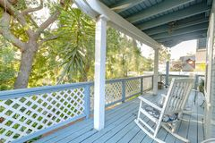 Take a rest with a white rocking chair on the deck stock photos