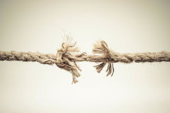 Take a risk. Rope nearly torn apart isolated - risk concept Royalty Free Stock Image