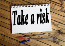 Take a risk word. On notepad Stock Image