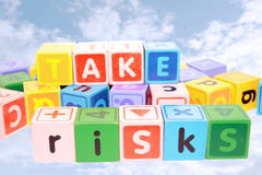 Take risks in colored play blocks Royalty Free Stock Photo