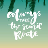 Always take the scenic route. Inspirational quote about life and travel. Hand lettering saying on tropical gradient Royalty Free Stock Image