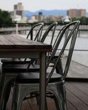 Take a seat. Empty seats at an outdoor table Stock Photography