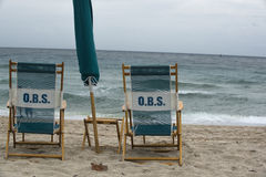 Take a seat. The wonder of the ocean and chairs royalty free stock photography