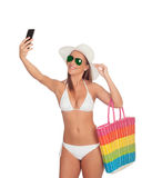Take a self portrait with her smart phone Royalty Free Stock Photography