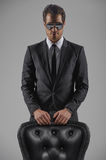 Take a sit. Full length of confident young businessmen leaning o Stock Photo