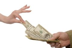 Take some money. Womans hand taking money fron mans hand stock images