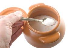 Take sugar. The sugar pot on the white background Royalty Free Stock Photos