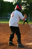 Take a swing. Youth at bat Stock Image
