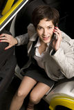 Business Woman Takes Taxi Emerges on Phone stock photos