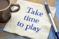 Take time to play reminder on napkin Stock Image