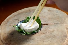 Take tofu with chopstick Stock Image