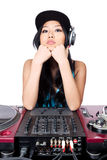 Take your best shot. A young female Asian DJ posing for a photo in front of her gear Stock Photos