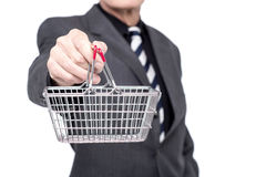 Take your business to e-commerce level. Cropped image of businessman showing mini shopping cart Stock Photo