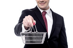 Take your business to e-commerce level. Cropped image of businessman showing shopping cart Stock Photos