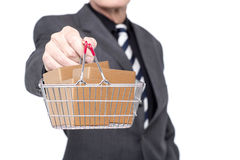Take your business to e-commerce level. A stack of cartons in a shopping cart Stock Images